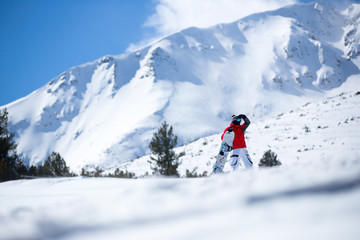 sportsman with snowboard