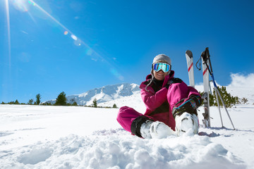Skier resting on the ski slope