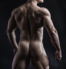 Body of Fit Totally Naked Man Facing Back, Exposing Buttocks