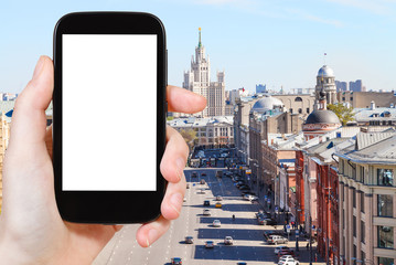 smartphone with cut out screen and Moscow street