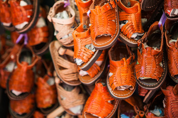 Handmade leather children shoes and sandals.