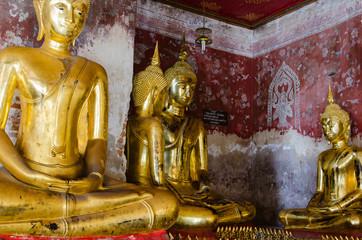 Veranda of Gild Buddha Sculptures at Wat Suthat, Bangkok of Thailand.