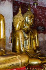 Gild Buddha Sculpture at Ancient Veranda of Wat Suthat, Bangkok of Thailand.