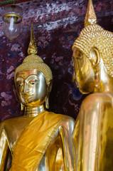 Gild Buddha Sculpture at Ancient Veranda of Wat Suthat, Bangkok of Thailand.