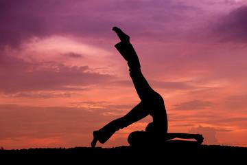 Fotobehang School de yoga Silhouette of a beautiful Yoga woman
