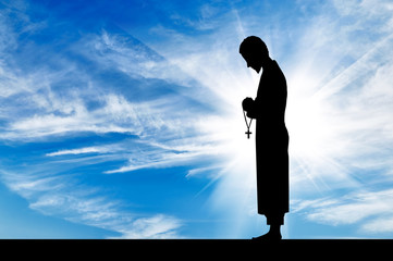 Silhouette of a priest