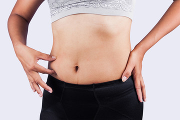 woman pinching belly fat after weight loss,body slim