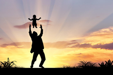 Silhouette of a happy father and child