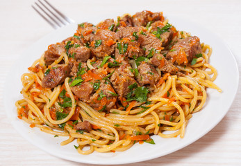 Pieces of meat and vegetables with spaghetti
