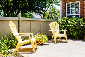 Yellow Adirondack Chairs on Patio