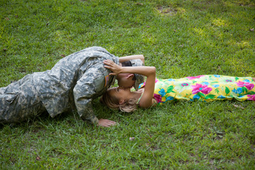 Couple laying in the grass and kissing