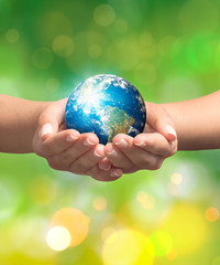 Woman hands holding earth. Save the earth concept.