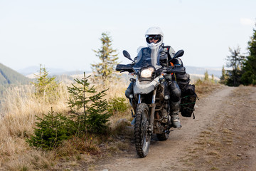 Motorbiker travelling in autumn mountains