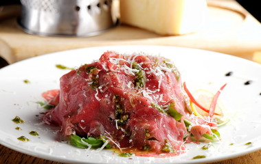 Fine dining, Beef carpaccio with pesto genovese, parmesan cheese, capers and rocket salad
