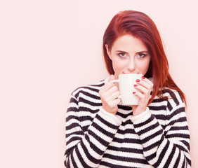 woman with white cup