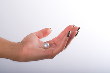 Nail art and pearls