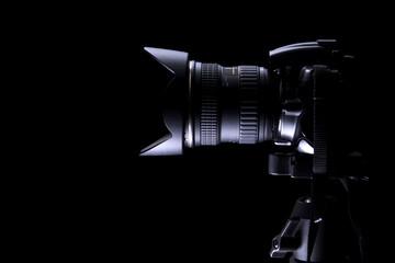 Professional DSLR camera on dark background