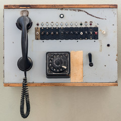 old analog telephone cell with jog dial in wooden box