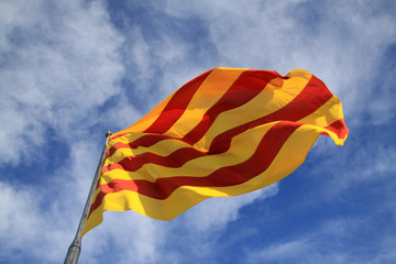 BARCELONA, CATALONIA, SPAIN - AUGUST 31, 2012: Catalan flag fluttering in the wind