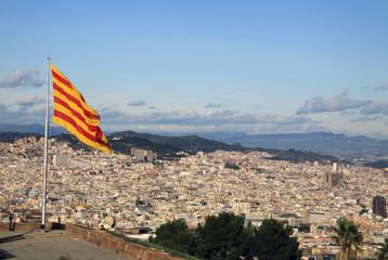 BARCELONA, CATALONIA, SPAIN - DECEMBER 14, 2011: Catalan flag fluttering in the wind in Montjuic Castle