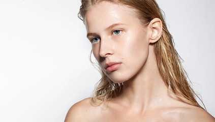 Young woman with clean shiny skin and full lips with natural beauty