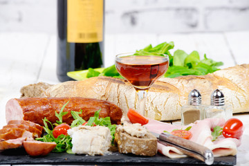 charcuterie plate with wine bread and tomatoes