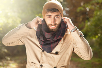 Outdoor portrait of handsome man with beard.