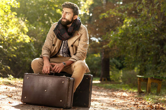 Fashionable men in autumn park.
