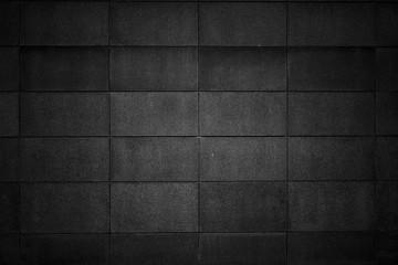Textured black grunge concrete background