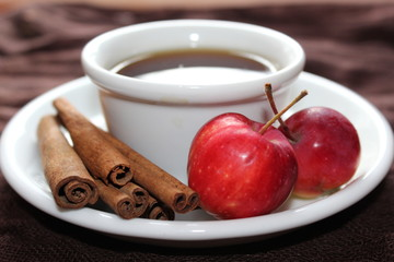 Cup of tea with apples and cinnamon