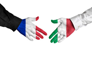 France and Italy leaders shaking hands on a deal agreement