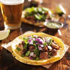 barbacoa beef mexican street tacos on soft yellow corn tortillas
