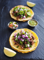 two authentic mexican street tacos with barbacoa beef