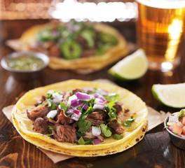 mexican beef barbacoa street tacos on soft yellow corn tortillas