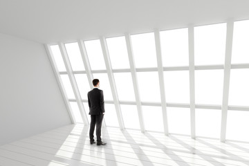 Fototapete - Businessman in the white loft interior