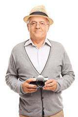 Vertical shot of a senior gentleman holding a camera