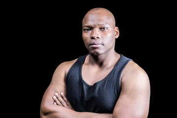 Portrait of bald bodybuilder with arms crossed