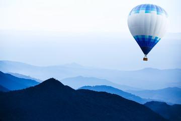 Hot air balloon over mountain