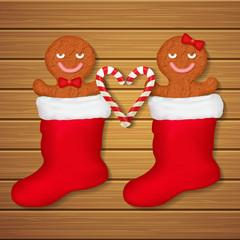 loving couple of gingerbread cookies in red socks