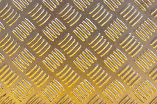 Yellow metal diamond plate pattern background.