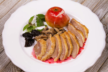 Roasted Duck Breasts with Mushroom, Apple and Plums Stuffing in Red Wine Sause