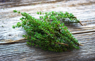 Fresh organic thyme on a wooden background