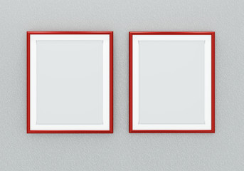 Blank red picture frames over grey wall