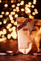 Sparkling bokeh of Christmas lights with gifts