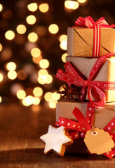 Christmas background with gifts and bokeh