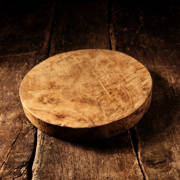 Old round rustic wooden cheese board
