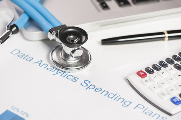 Stethoscope and financial papers