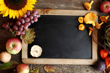 Autumn cooking ingredients with a vintage slate
