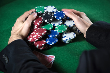 Man collecting casino chips in the foreground