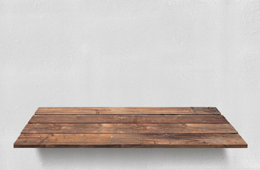 Wood plank table with white concrete wall background
